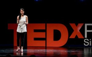 Maggie Lee giving a Ted Talk on Sustainability